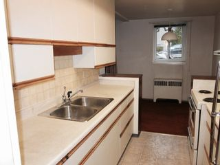 """Photo 12: 102 3530 CAMBIE Street in Vancouver: Cambie Condo for sale in """"BROCKVILLE MANOR"""" (Vancouver West)  : MLS®# R2226254"""