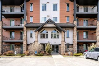 Photo 2: 2310 15 Sunset Square: Cochrane Apartment for sale : MLS®# A1088387