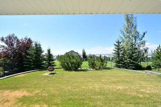 Photo 48: 303 GLENEAGLES View: Cochrane House for sale : MLS®# C4130061