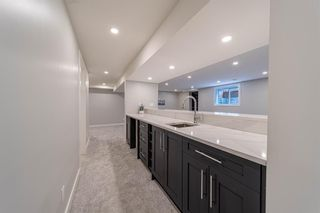 Photo 33: 944 Parkvalley Way SE in Calgary: Parkland Detached for sale : MLS®# A1153564