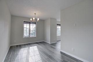 Photo 7: 30 MACEWAN RIDGE Place in Calgary: MacEwan Glen Detached for sale : MLS®# A1092445