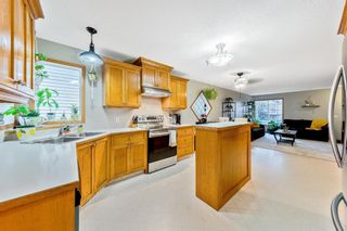 Photo 14: 56 Luxstone Crescent SW: Airdrie Detached for sale : MLS®# A1131266