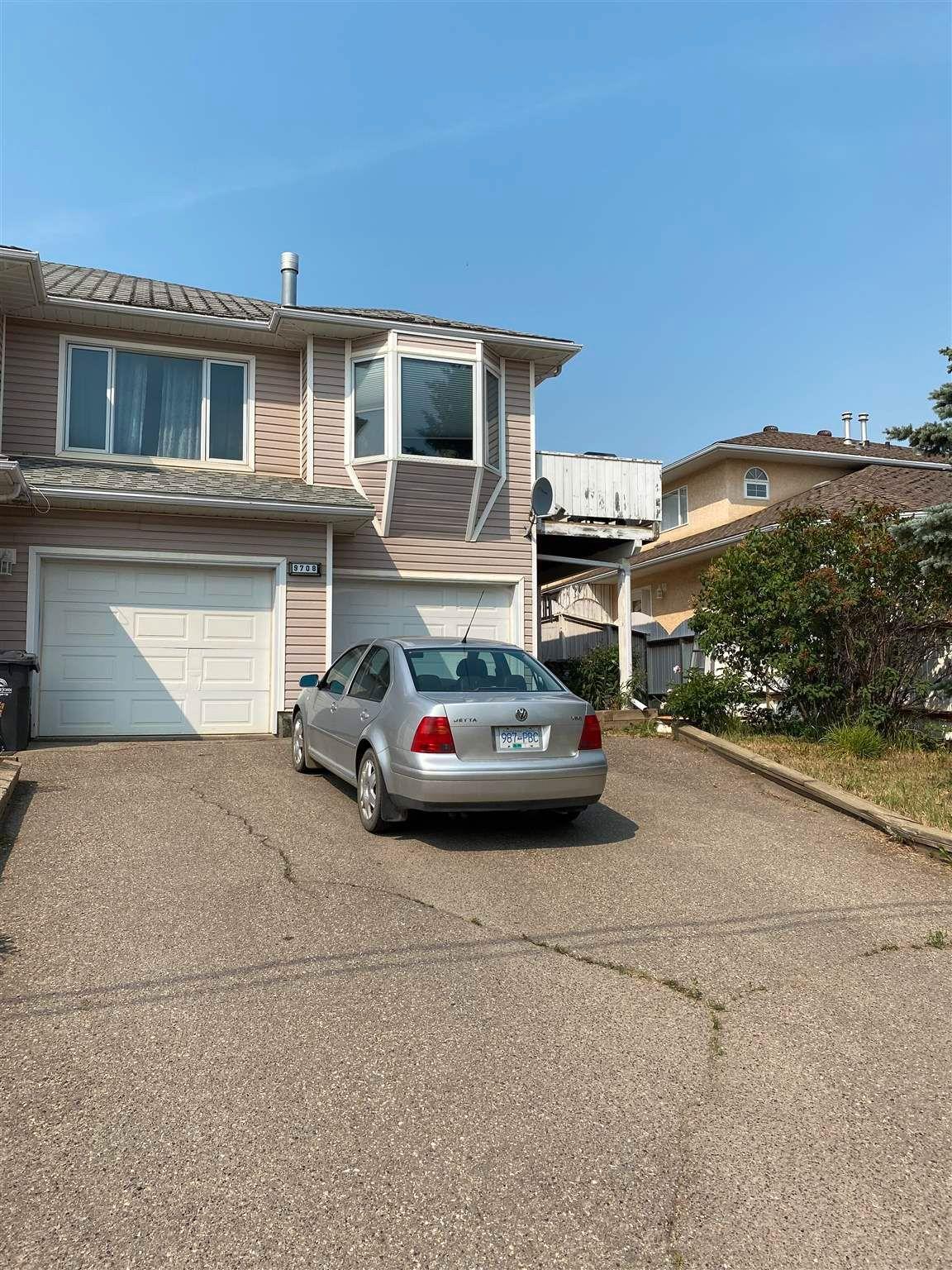 Main Photo: 9708 98A Avenue in Fort St. John: Fort St. John - City SE 1/2 Duplex for sale (Fort St. John (Zone 60))  : MLS®# R2601828