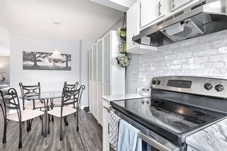 Photo 11: 104 7172 Coach Hill Road SW in Calgary: Coach Hill Row/Townhouse for sale : MLS®# A1097069