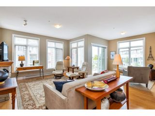 """Photo 3: 214 4211 BAYVIEW Street in Richmond: Steveston South Condo for sale in """"THE VILLAGE AT IMPERIAL LANDING"""" : MLS®# R2472507"""
