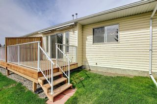 Photo 18: 8 12 Woodside Rise NW: Airdrie Row/Townhouse for sale : MLS®# A1108776