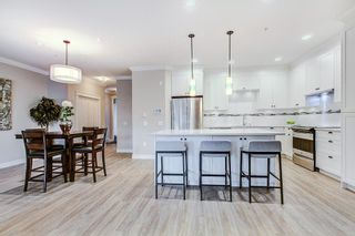 """Photo 3: 45 10525 240 Street in Maple Ridge: East Central Townhouse for sale in """"MAGNOLIA GROVE"""" : MLS®# R2256172"""