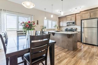 Photo 8: 617 HILLCREST Road SW: Airdrie Row/Townhouse for sale : MLS®# C4306050