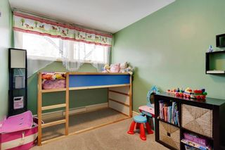 Photo 17: 49 MEADOWVIEW RD SW in Calgary: Meadowlark Park House for sale : MLS®# C4104032