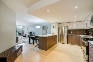 """Photo 7: 102 1450 PENNYFARTHING Drive in Vancouver: False Creek Condo for sale in """"Harbour Cove"""" (Vancouver West)  : MLS®# R2560607"""
