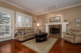 Photo 5: 356 SIGNATURE Court SW in Calgary: Signal Hill Semi Detached for sale : MLS®# C4220141