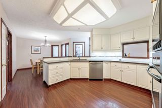 Photo 18: 217 Signature Way SW in Calgary: Signal Hill Detached for sale : MLS®# A1148692