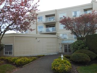 "Photo 1: 301 9295 122 Street in Surrey: Queen Mary Park Surrey Condo for sale in ""Kensington Gate"" : MLS®# F1408813"