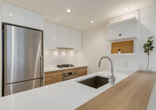 Photo 5: 406 108 Waterfront Court SW in Calgary: Chinatown Apartment for sale : MLS®# A1108137
