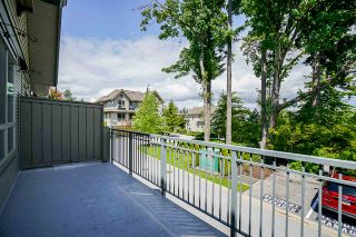 """Photo 23: 8 2738 158 Street in Surrey: Grandview Surrey Townhouse for sale in """"CATHEDRAL GROVE"""" (South Surrey White Rock)  : MLS®# R2463712"""