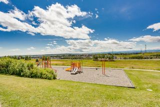 Photo 22: 7 124 Rockyledge View NW in Calgary: Rocky Ridge Row/Townhouse for sale : MLS®# A1111501