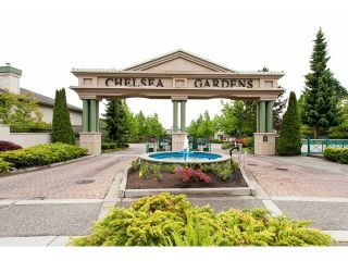 """Photo 1: 128 13888 70TH Avenue in Surrey: East Newton Townhouse for sale in """"Chelsea Gardens"""" : MLS®# F1440954"""