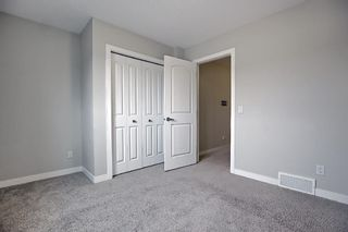 Photo 31: 102 Clydesdale Way: Cochrane Row/Townhouse for sale : MLS®# A1117864