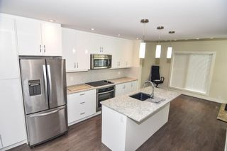 Photo 22: 207 20 Brentwood Common NW in Calgary: Brentwood Row/Townhouse for sale : MLS®# A1143237