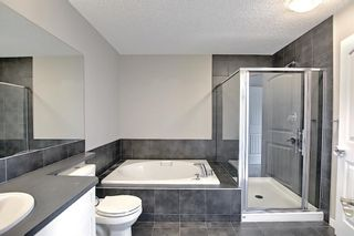 Photo 34: 566 River Heights Crescent: Cochrane Semi Detached for sale : MLS®# A1129968