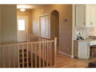 Photo 6: 3 CIMARRON ESTATES Way: Okotoks House for sale : MLS®# C3656474