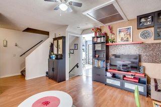 Photo 9: 111 ERIN RIDGE Road SE in Calgary: Erin Woods House for sale : MLS®# C4162823