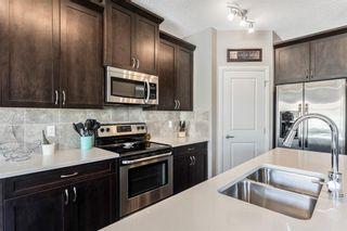 Photo 4: 205 Heritage Boulevard: Cochrane Detached for sale : MLS®# A1122442