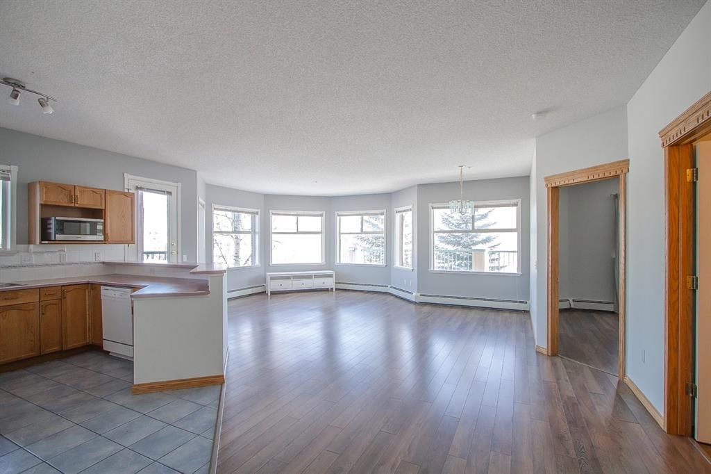 Main Photo: 113 200 Lincoln Way SW in Calgary: Lincoln Park Apartment for sale : MLS®# A1068897