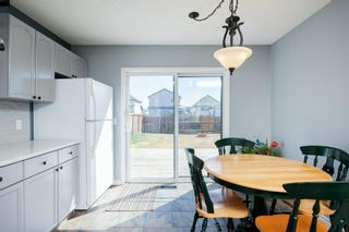 Photo 8: 26 Mt Aberdeen Link SE in Calgary: McKenzie Lake Detached for sale : MLS®# A1095540