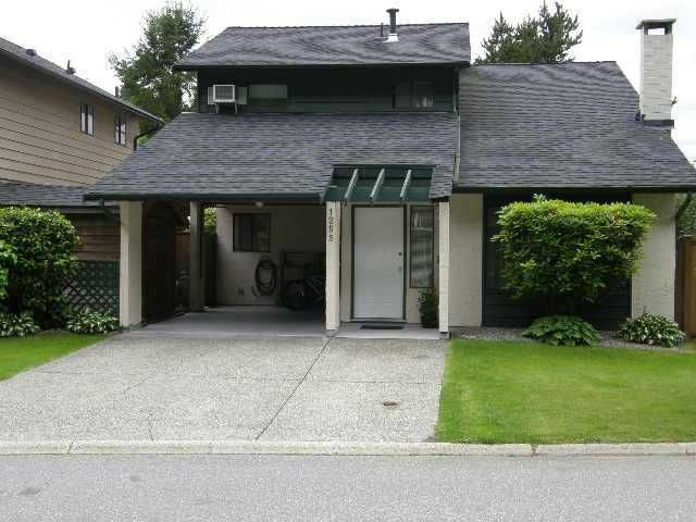 """Main Photo: 1255 BLUFF Drive in Coquitlam: River Springs House for sale in """"RIVER SPRINGS"""" : MLS®# V1010046"""