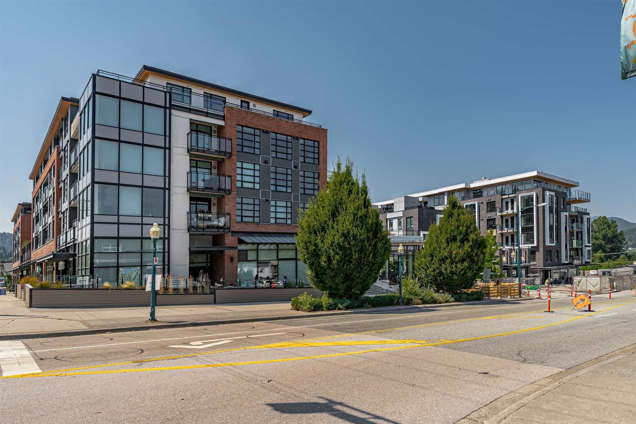 """Main Photo: 409 95 MOODY Street in Port Moody: Port Moody Centre Condo for sale in """"The Station by Aragon"""" : MLS®# R2602041"""