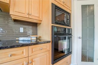 Photo 17: 152 STRATHLEA Place SW in Calgary: Strathcona Park House for sale : MLS®# C4130863