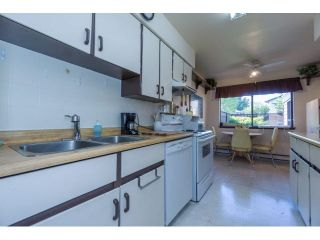 """Photo 4: 145 9455 PRINCE CHARLES Boulevard in Surrey: Queen Mary Park Surrey Townhouse for sale in """"Queen Mary Park"""" : MLS®# F1440683"""