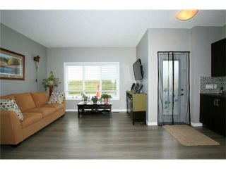 Photo 13: 510 RIVER HEIGHTS Crescent: Cochrane House for sale : MLS®# C4074491