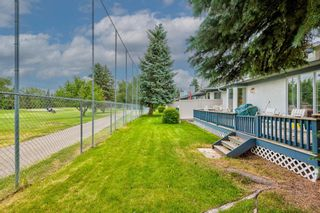 Photo 48: 34 Woodmeadow Close SW in Calgary: Woodlands Semi Detached for sale : MLS®# A1127227