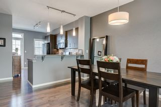 Photo 9: 440 Ascot Circle SW in Calgary: Aspen Woods Row/Townhouse for sale : MLS®# A1090678