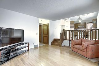 Photo 9: 152 Woodmark Crescent SW in Calgary: Woodbine Detached for sale : MLS®# A1054645