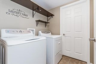 Photo 5: 145 WINDSTONE Avenue SW: Airdrie Row/Townhouse for sale : MLS®# C4260990