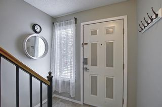 Photo 4: 101 Country Hills Villas NW in Calgary: Country Hills Row/Townhouse for sale : MLS®# A1089645