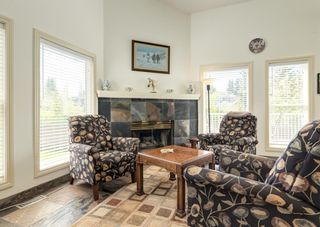 Photo 10: 231 Shawnee Gardens SW in Calgary: Shawnee Slopes Detached for sale : MLS®# A1114350
