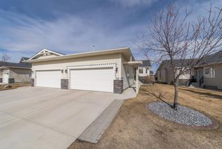 Main Photo: 210 Riverside Crescent NW: High River Semi Detached for sale : MLS®# A1086875