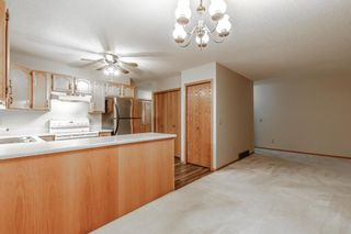 Photo 7: 10 Sandarac Circle NW in Calgary: Sandstone Valley Row/Townhouse for sale : MLS®# A1145487