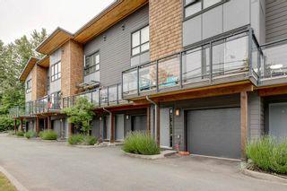 Photo 1: 40160 GOVERNMENT ROAD in Squamish: Garibaldi Estates Townhouse for sale : MLS®# R2281164