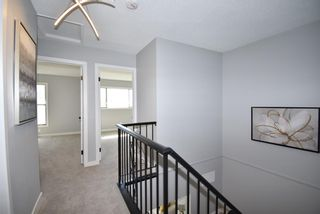 Photo 21: 5 903 67 Avenue SW in Calgary: Kingsland Row/Townhouse for sale : MLS®# A1115343