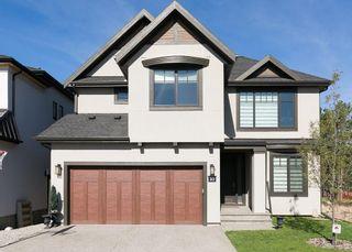 Photo 1: 30 ASPEN RIDGE Park SW in Calgary: Aspen Woods House for sale : MLS®# C4119944