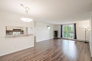 Photo 5: 204 2022 CANYON MEADOWS Drive SE in Calgary: Queensland Apartment for sale : MLS®# A1028195