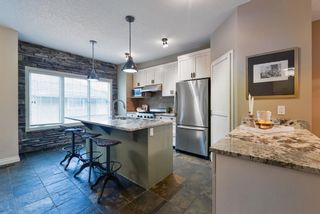 Photo 13: 175 Ypres Green SW in Calgary: Garrison Woods Row/Townhouse for sale : MLS®# A1103647
