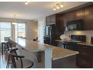Photo 2: 418 WALDEN Drive SE in Calgary: Walden House for sale : MLS®# C3649474