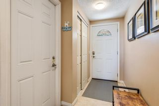 Photo 2: 1524 Ranchlands Road NW in Calgary: Ranchlands Row/Townhouse for sale : MLS®# A1113238