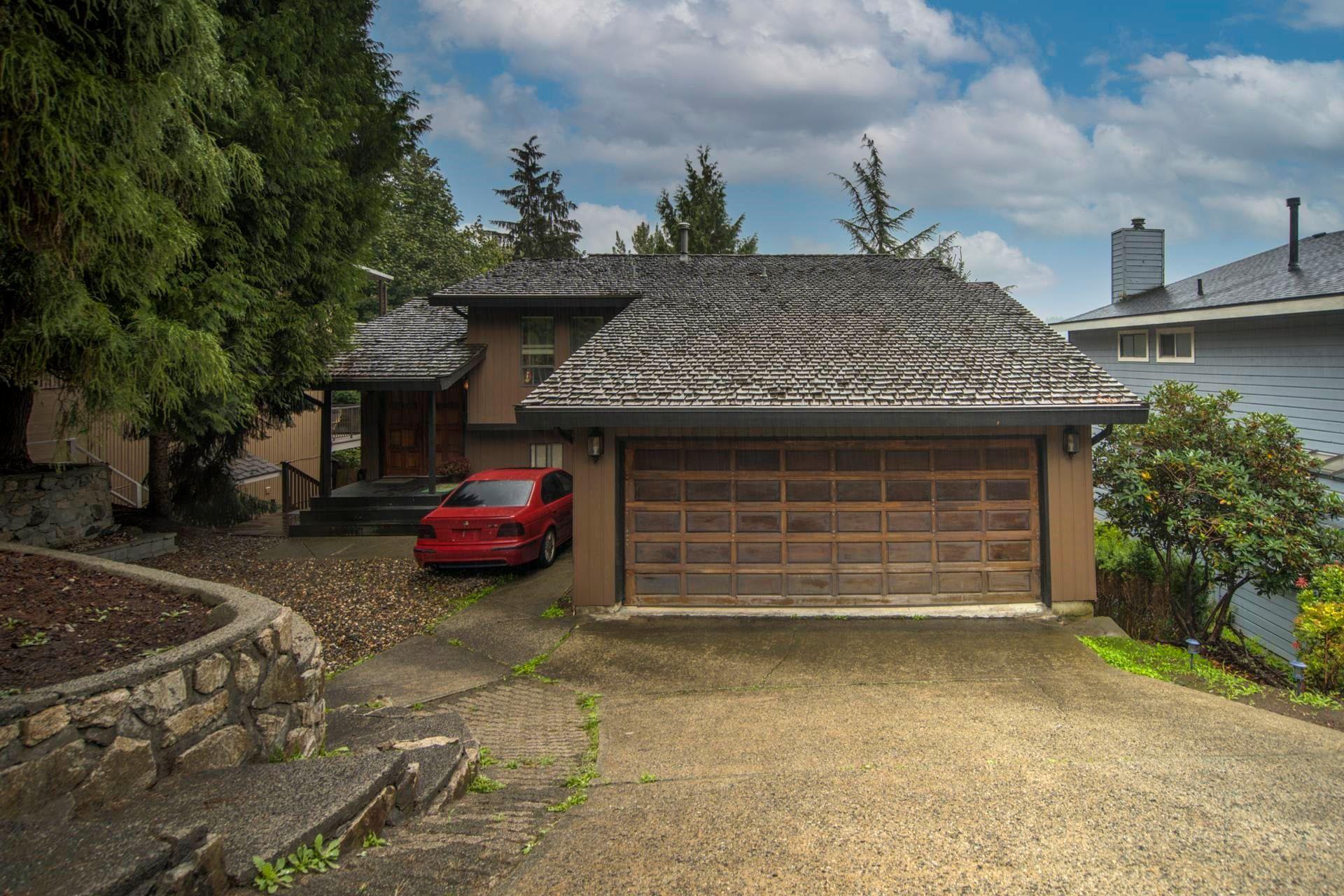"Main Photo: 1305 CHARTER HILL Drive in Coquitlam: Upper Eagle Ridge House for sale in ""UPPER EAGLE RIDGE"" : MLS®# R2616938"
